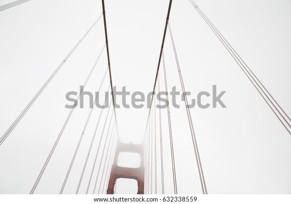 Golden Gate Bridge on Foggy Day in San Francisco White Cloudy Sky