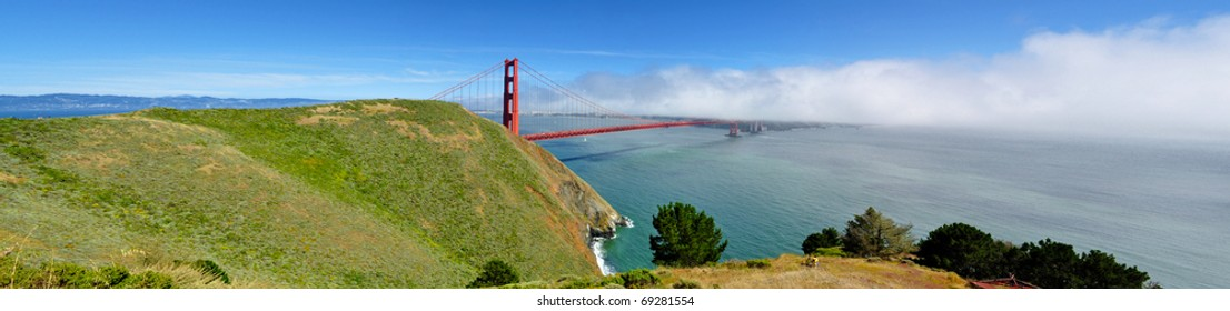 Golden Gate Bridge Panorama from park with fog rolling in from the Pacific Ocean