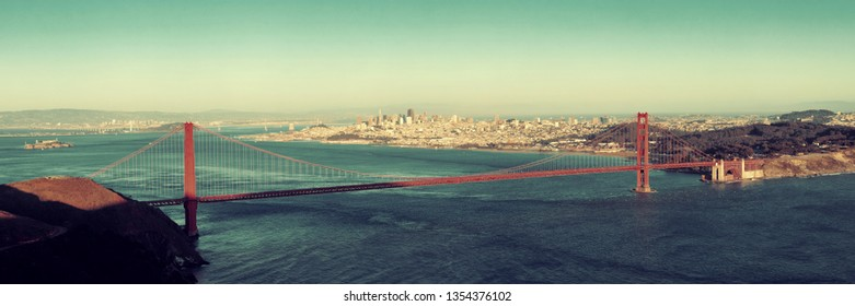 Golden Gate Bridge panorama at sunset in San Francisco as the famous landmark.