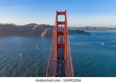 Golden Gate Bridge, San Francisco, California, as seen from the air. Drone footage. Viewpoint is hovering above bridge, cars visible.