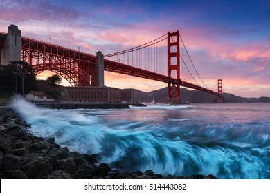 Golden Gate bridge in San Francisco at sunset with amazing seashore waves in foreground. San Francisco background. Art photograph.