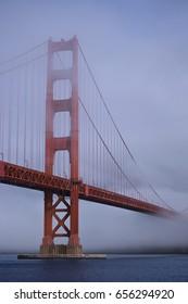 The Golden Gate Bridge in San Francisco, covered in fog.