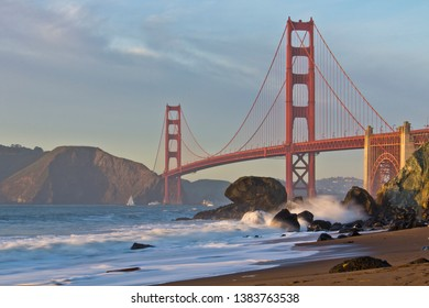The Golden Gate bridge as seen from Marshall's beach during sunset.