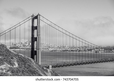 Golden Gate Bridge with the skyline of San Francisco in the background on a beautiful sunny day with blue sky and clouds in summer - Panoramic view from Battery Spencer - California, USA