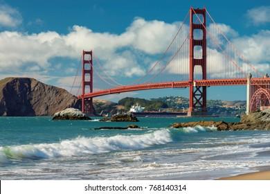 Golden Gate Bridge at sunset seen from San Francisco beach, California.