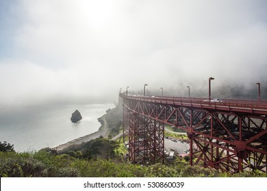 Golden Gate Bridge surrounded by fog after sunrise in San Francisco, California, USA.