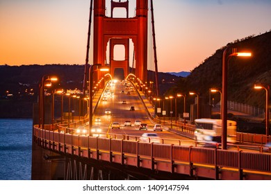 The Golden Gate Bridge is a suspension bridge spanning the Golden Gate, the one-mile-wide strait, connecting San Francisco and Marin County, carrying  U.S. Route 101