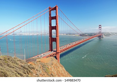 Golden Gate Bridge - a suspension bridge spanning the Golden Gate, the opening of the San Francisco Bay into the Pacific Ocean
