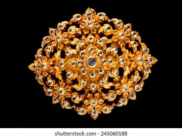 golden gem jewelry isolated on black