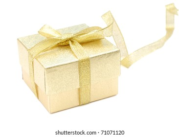 A golden gift with a long ribbon