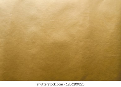 Golden gift wrap paper background or texture