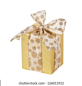 Golden gift wrapped present with dotted bow isolated over white (includes clipping path)