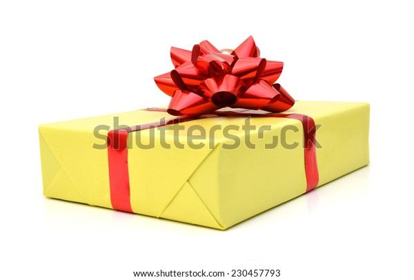 Golden gift wrapped present with red ribbon bow isolated on white