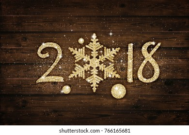 Golden glitter 2018 snowflake over black background. Holiday card