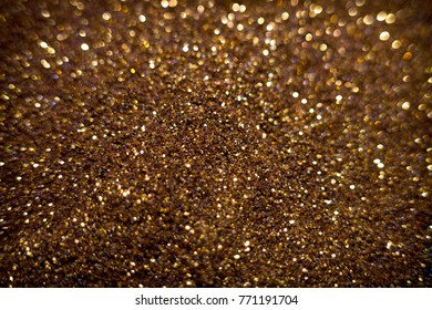 Golden  glitter background with bokeh abstract blur effect