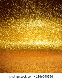 Golden glitter lights background. defocused