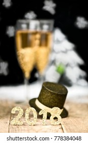 a golden glitter number 2018 with decoration