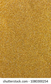 Golden glitter sparkling background. Shiny glam abstract texture.