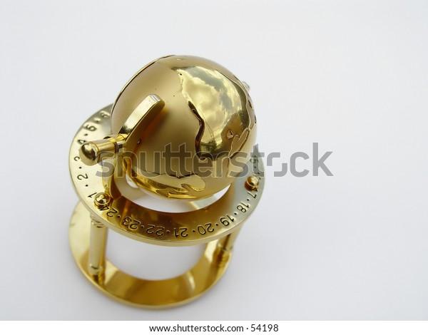 Golden globe isolated on white background