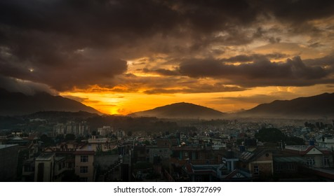 Golden glow of setting sun and city view of Kathmandu valley in Nepal.