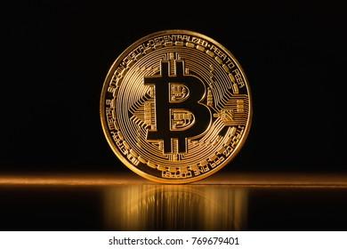 Golden glowing  Bitcoin