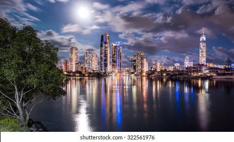 The Golden Gold Coast Skyline During A Full Moon Illuminating The Landscape With A Reflection In The Calm Water, Surfers Paradise, Queensland, Australia