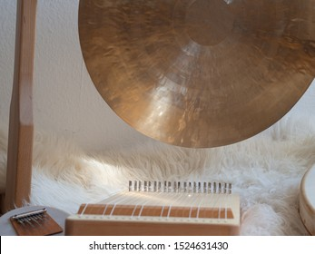 Golden Gong with Monochord sound healing instruments for ceremony