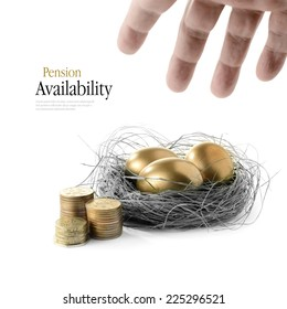 Golden goose eggs placed in a authentic looking grass nest against a white background with hand reaching. Concept image for pension savings and investments availability. Copy space.