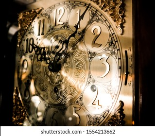 Golden grandfather clock close up after 10:00 pm time at night with regal chimes