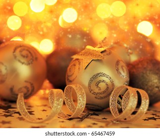 Golden Holiday background with Christmas tree bauble ornament and star decoration over abstract defocus lights