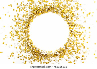 Golden holiday gifts. Gold bar. White background. Satin ribbon and confetti.
