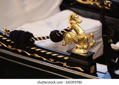 Golden horse  on a venetian gondola, Venice, Italy