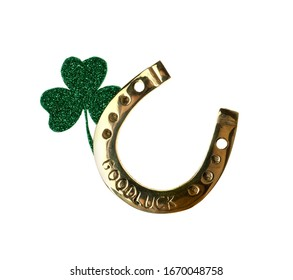 Golden horseshoe with phrase GOOD LUCK and clover on white background. St. Patrick's Day celebration