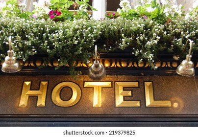 golden hotel sign - close up