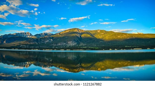 Golden Hour Columbia Lake Reflection, Fairmont Hot Springs, British Columbia, Canada. Canadian Rockies Landscape.