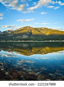 Golden Hour Columbia Lake Reflection, Fairmont Hot Sprigns, British Columbia, Canada. Canadian Rockies Landscape.