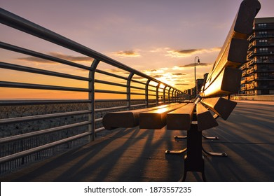 The golden hour on Long Island's south shore from the perspective of a bench on the boardwalk in Long Beach.