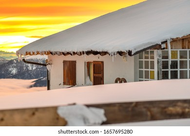 Golden hour in snowy mountains, Kronplatz, Italy. It is a mountain of the Dolomites in South Tyrol, with a summit elevation of 2,275 metres (7,464 ft) above sea level