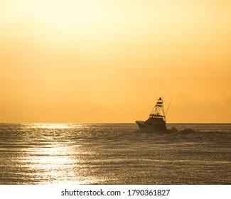 Golden hour sport fishing boat in the Atlantic Ocean