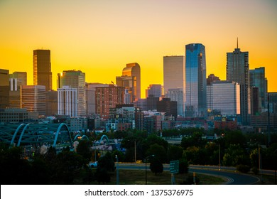 Golden hour sunrise silhouette Denver Colorado skyline cityscape the mile high city along the front range of the Rocky Mountains Rising skyscrapers and condo new development