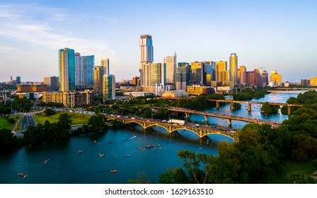 Golden Hour Golden Sunshine on the Downtown Towers and Modern Skyscrapers in Austin Texas USA skyline cityscape during afternoon sunset with Town Lake and Bridges
