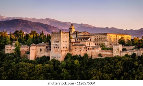 A golden hour view of the Nazari and Charles V Palaces in the Alhambra, Granada Spain