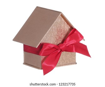 golden house with bow