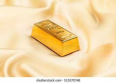 Golden ingot on golden silk