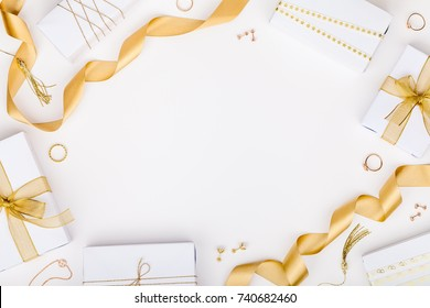 golden jewelry and gift boxes on white background with copy space for text. fashion and shopping concept. wedding, marriage or birthday composition. flat lay, top view