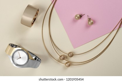 Golden jewelry set hand watch on paper background