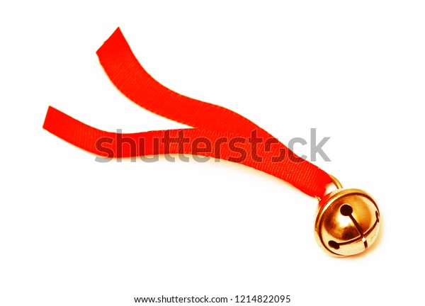 Golden jingle bell and red ribbon