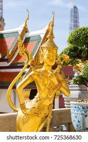 Golden Kinnari (bird and Human) statue at Temple of Wat Phra Kaew in Grand Royal Palace.Bangkok ,Thailand