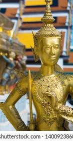 golden Kinnari statue at Grand Palace in Bangkok, Thailand