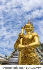 A Golden Kinnari statue in Royal Palace, in Bangkok Thailand.